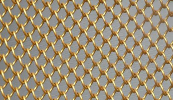 Brass chain link fence shows golden appearance