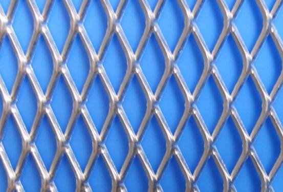 Galvanized expanded fence with diamond mesh opening on the blue background